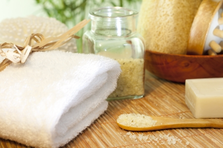 towels luxury: Bath salt and towel on bamboo mat spa concept still life Stock Photo