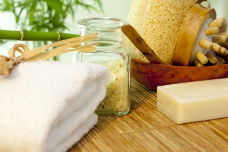 Bath salt and towel on bamboo mat spa concept still life photo