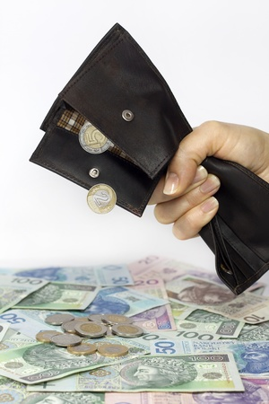 inland: Bank wife and tax squeezed polish money out of wallet concept Stock Photo