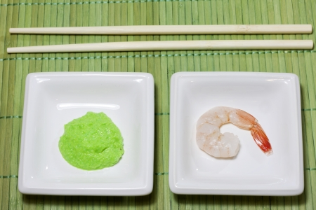 horseradish: Sushi shrimp and wasabi on bamboo mat