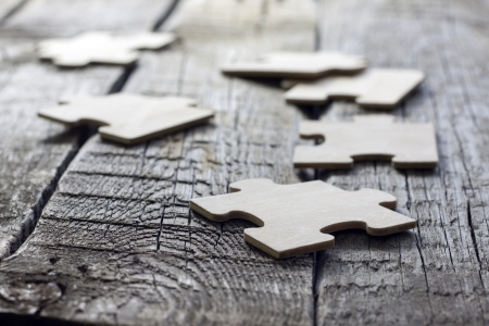 business solutions: Puzzle on wooden boards team business concept Stock Photo