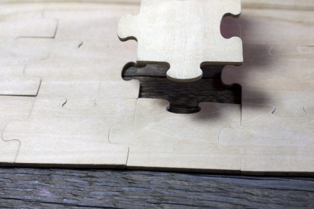 Puzzle on wooden boards team business concept photo