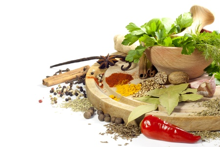 Variety of herbs and spices with mortar on white background Stock Photo - 17566815
