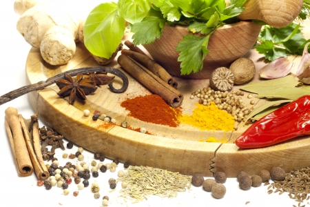 Variety of herbs and spices with mortar on white background Stock Photo - 17566825