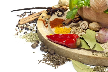 Variety of herbs and spices with mortar on white background Stock Photo - 17566823