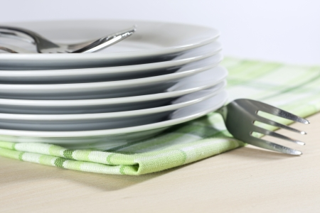 Plates on tablecloth in kitchen abstract food background photo