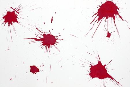 Red blood splash on white paper