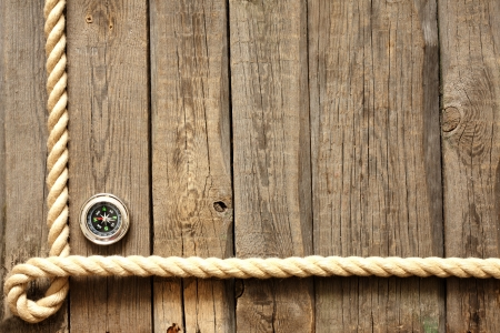 jute: Old wooden planks and rope with compass vintage background