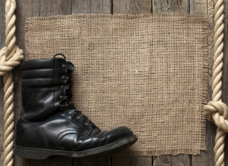 Old military shoes on wooden boards abstract background concept Stock Photo - 18436724