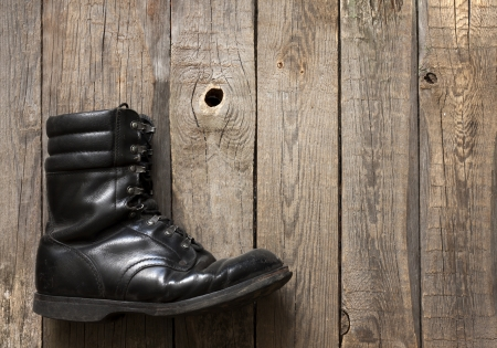 Old military shoes on wooden boards abstract background concept Stock Photo - 18436723