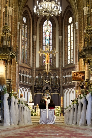 Wedding ceremony in church with groom and bride concept photo