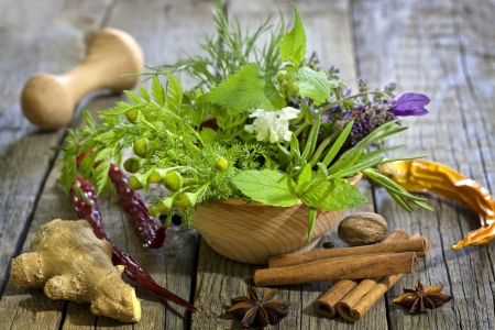 Fresh herbs and spices on vintage wooden boards closeup photo