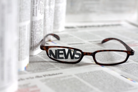 gazette: News letters on newspapers with blurred background concept  Stock Photo