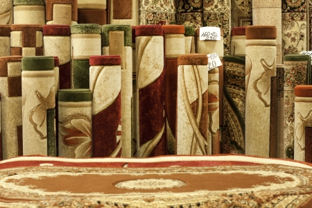 Colorful carpets in the store photo