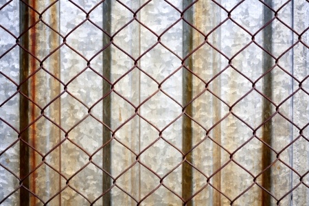 Rusty grunge metal background texture with grid photo