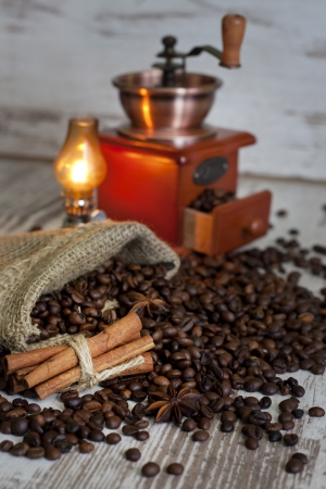 Cup of coffee on vintage white planks abstract still life photo