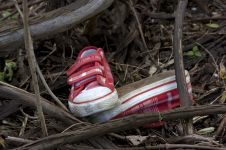 Forensics and investigation kid shoes in the forest photo