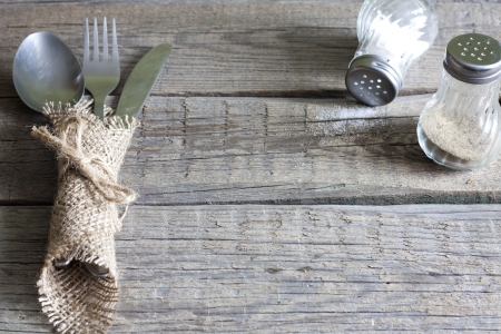 Cutlery kitchenware on old wooden boards background food concept photo