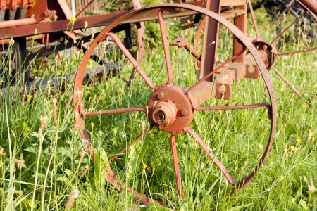 agriculture machinery: Old agriculture machinery outdated technology concept