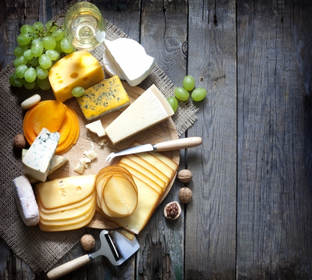 Various types of cheese with empty space background concept photo