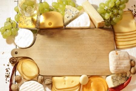 Diverse soorten kaas met lege ruimte, achtergrond, concept Stockfoto