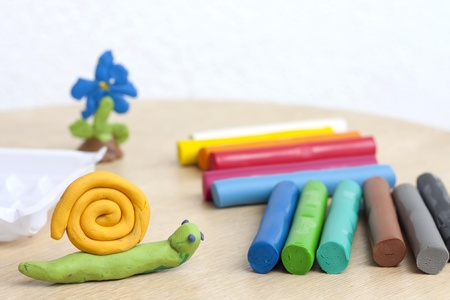 clay modeling: Plasticine on table with snail abstract background concept