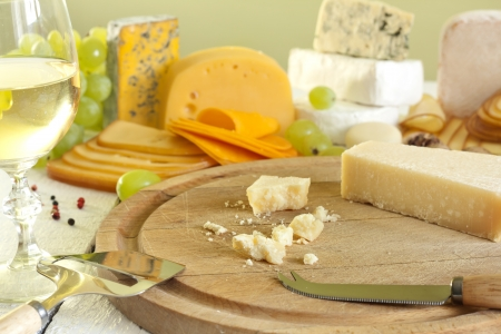 Grana padano cheese on cutting board photo