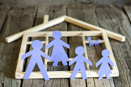 single parents: Family and home concept, paper silhouettes on wooden boards