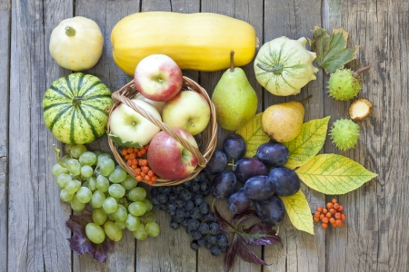 Fruits and vegetables in autumn season on vintage wooden boards photo