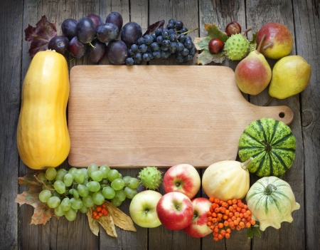 thanksgiving background: Autumn fruits and vegetables and empty cutting board Stock Photo
