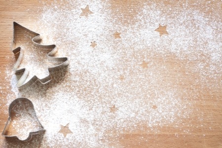 flour: Abstract Christmas food background with cookies molds and flour