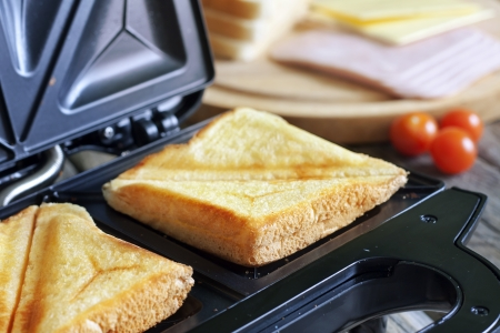 Sandwich toaster with toast closeup