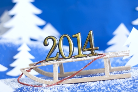 2014 new year numbers on sled abstract on snow background Stock Photo - 22627161