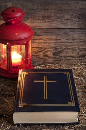 Bible and Christmas time abstract background in night photo