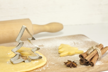 Christmas baking food concept with tree and dough photo