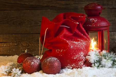 Christmas lantern gifts and baubles on snow abstract background photo