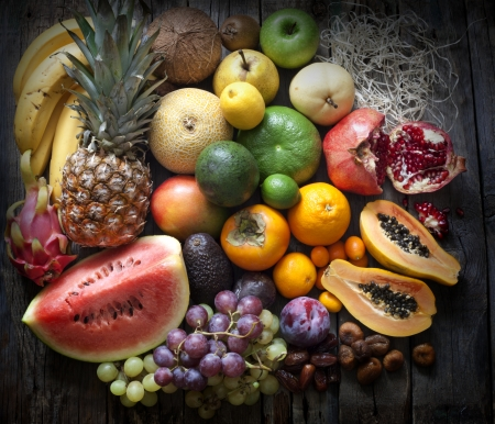 Exotic fruits variety still life on vintage wooden boards photo