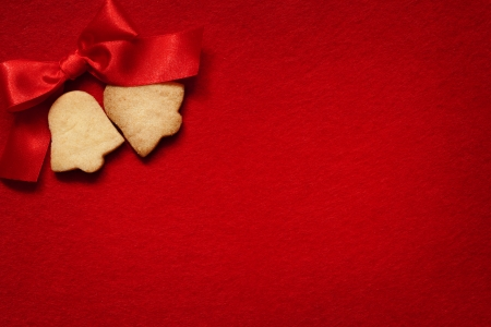 Christmas abstract background with cookies on red fabric photo