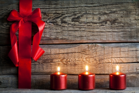 Christmas abstract background with red ribbon on vintage boards photo