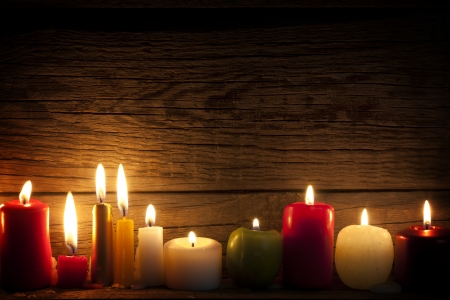 candle: Candles in night in christmas mood on vintage wooden boards