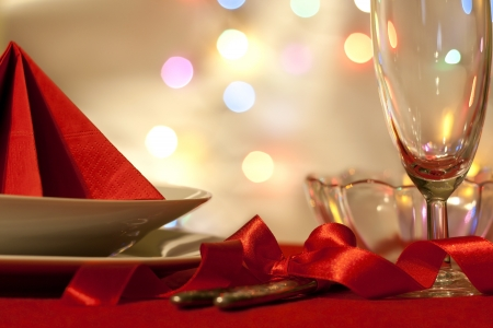 Christmas table abstract background with red ribbon and dishware photo