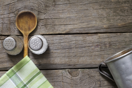 Abstract food background on vintage boards with wooden spoon photo
