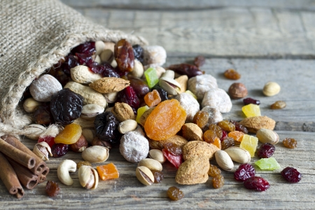 Nuts and dried fruits on vintage wooden boards still life Standard-Bild