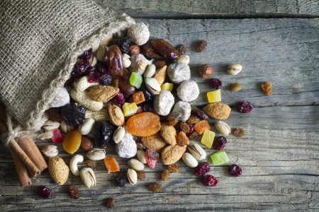 mix fruit: Nuts and dried fruits on vintage wooden boards still life Stock Photo