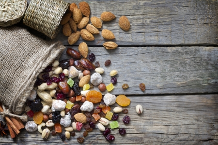 Nuts and dried fruits on vintage wooden boards still life Stock Photo