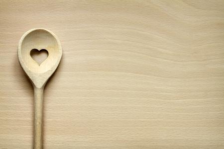 Utensilios de cocina de madera en la tabla de cortar alimentos de fondo abstracto Foto de archivo - 24731461