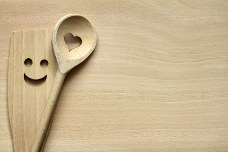 Wooden kitchenware on cutting board abstract food background