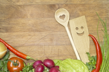 Vegetables and kitchenware on cutting board background concept Stock Photo
