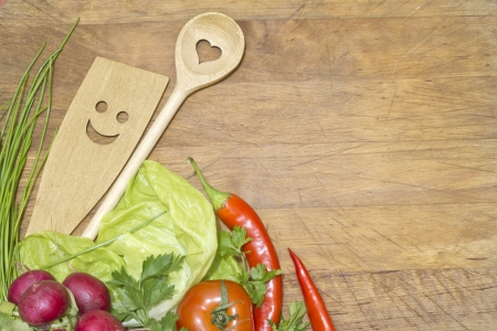 Vegetables and kitchenware on cutting board background concept Standard-Bild