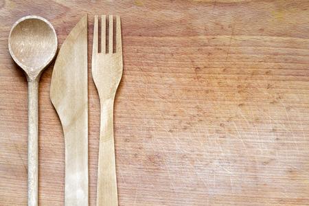 Houten bestek op de snijplank voedsel abstracte achtergrond